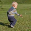 Little boy running on the grass — Stock Photo
