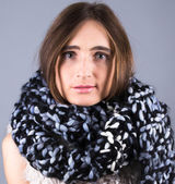 Girl with a big knitted scarf — Stockfoto