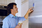 Man looking on refrigerator — Stock Photo
