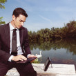 Businessman using laptop outdoors b — Stock Photo