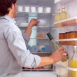 Stock Photo: Mstanding near freezer l
