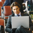 Businessman sitting in the airport b — Stock Photo