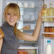 Stock Photo: Womlooking in fridge vp