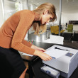 Woman next to printer l — Stock Photo