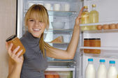 Woman looking in the fridge vp — Stock Photo