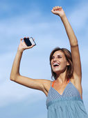 Happy woman with mobile phone — Stock Photo