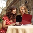 Happy businesswomen with laptop — Stock Photo
