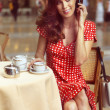 Beautiful woman sitting in a Cafe with mobile — Stock Photo