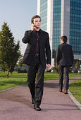 Businessman walking near office a — Stock Photo