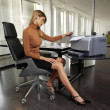 Stock Photo: Womwith copy machine ssr