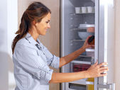 Woman in front of the fridge — Stock Photo