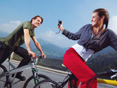 Couple on bicycles in the park — Stock Photo