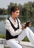 A woman with laptop in park cvb — Stock Photo