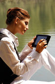 A woman with laptop in park ui — Stock Photo