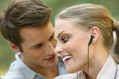Beautiful couple listening player  — ストック写真