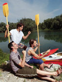 Friends having fun near river — Stock Photo