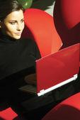 Young woman using laptop hukm — Stock Photo