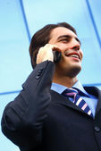 Businessman speaking on the telephone — Stock Photo