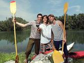 Men with canoe in nature io — Stock Photo