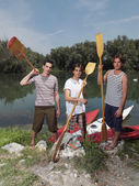Young men with kayaks — Stock Photo