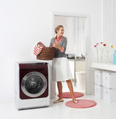 Woman doing a housework — Stock Photo