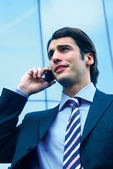 A businessman using mobile phone b — Stock Photo