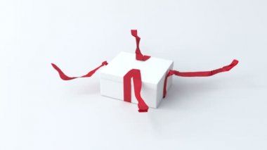 White, low gift box with red ribbon opening — Stock Video