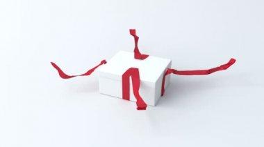 Vita, låga presentförpackning med rött band öppna — Stockvideo