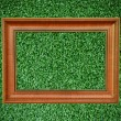 Stock Photo: Vintage wood picture frame on beautiful deep green grass texture