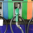 Several gasoline pump nozzles at petrol station — Stock Photo
