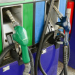 Several gasoline pump nozzles at petrol station — Stock Photo #27697731