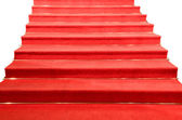 Stairs covered with red carpet isolated — Stock Photo