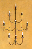 Vintage elegant candlestick on the wall — Stock Photo
