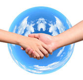Partner hand between a man and a woman on blue planet world in signal of protection and conservation — Stock Photo
