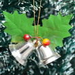 Stock Photo: Jingle bells on Christmas tree