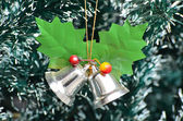 Jingle bells on Christmas tree — Stock Photo