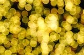 Defocused abstract yellow christmas background — Stock Photo