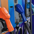 Several gasoline pump nozzles at petrol station, gasoline industry — Stock Photo