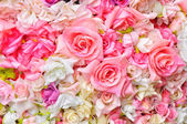 Artificial flowers background — Stock Photo