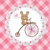 Cute hare on a bicycle (vector) — Stock Vector