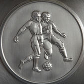 Bas-relief Footballers — Stock Photo