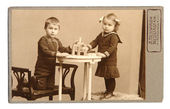 Old photo: sister and brother — Stock Photo