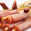 Stock Photo: Breadsticks with smoked ham