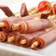 Breadsticks with smoked ham — Stock Photo