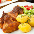 Roasted chicken wings with young potatoes — Stock Photo
