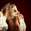 Evil woman with knife — Stock Photo #28641715