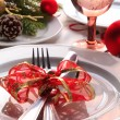 Christmas place setting with ribbon and christmas decorations — Stock Photo #29307123