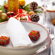 Christmas place setting with ribbon and christmas decorations — Stock Photo