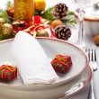 Christmas place setting with ribbon and christmas decorations — Stock Photo #29541501