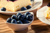 Blueberries served with cheesecak and a cap of coffee — Stock Photo